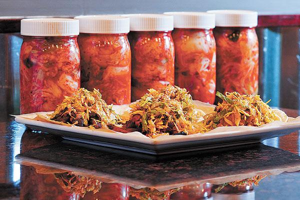 Korean tacos and jars of kimchi at Del Seoul