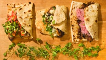 Gaztro-Wagon's beef shortrib, chicken thigh and Brie, and wild boar belly naanwiches
