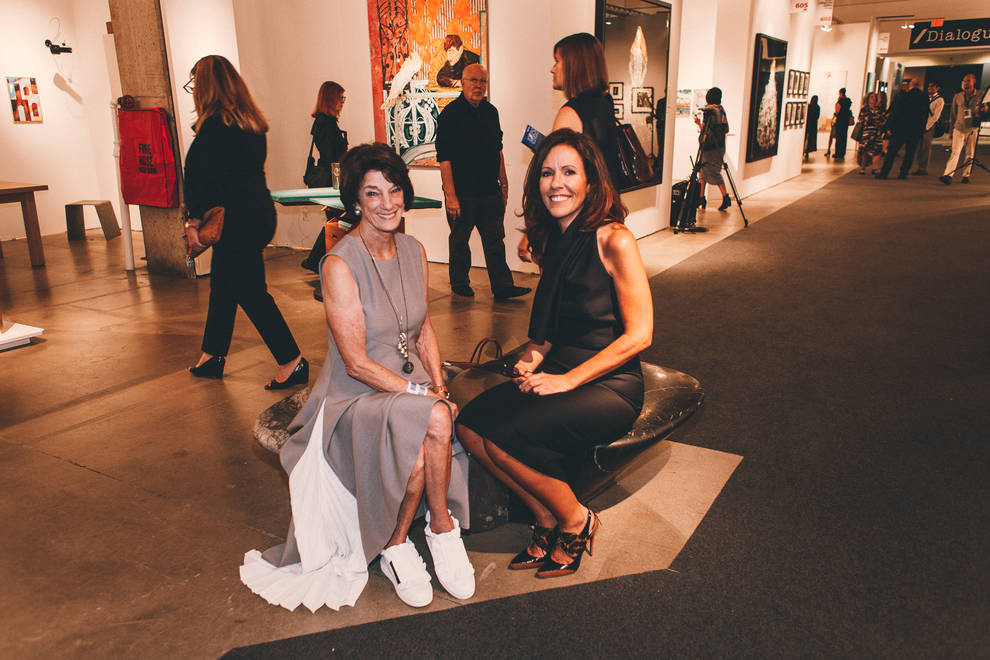 Anne Kaplan (left), in a gorgeous pleated dress with gym shoes, and Sara Albrecht