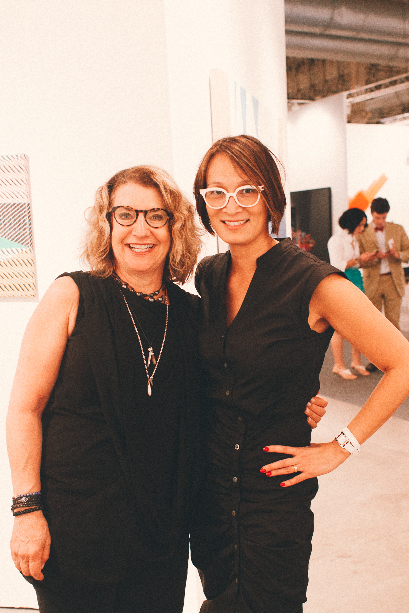 Katie Block (left) and Lisa Tung sport some of the best glasses at the fair.