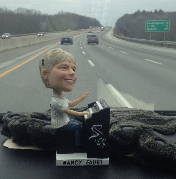 A Nancy Faust bobblehead accompanied the team on their drive to Boston.