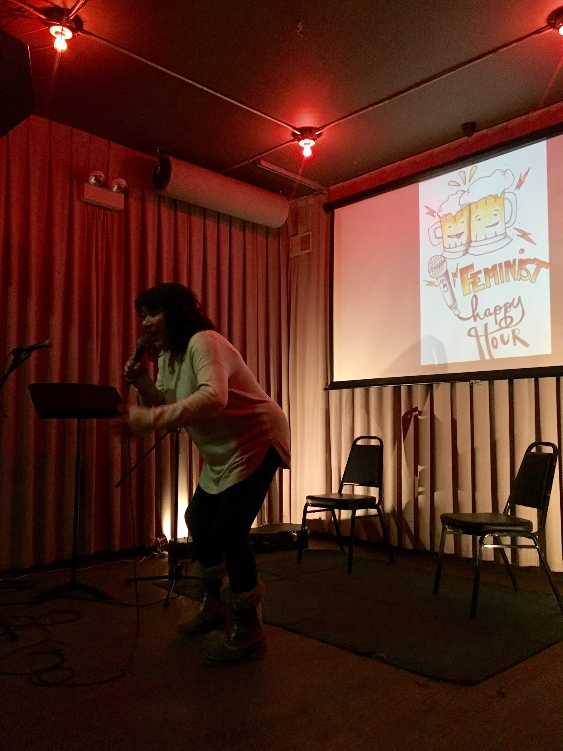 Elizabeth Gomez performs at a past Feminist Happy Hour. This month's show honors Obama's time in office.