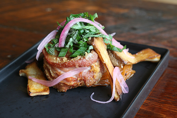 Tempura-battered and fried ponce, trumpet mushrooms, pickled onions, sesame leaves