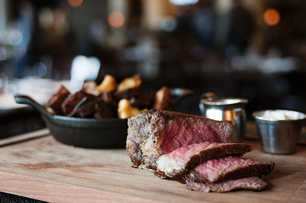Sliced beef sirloin served with horseradish butter