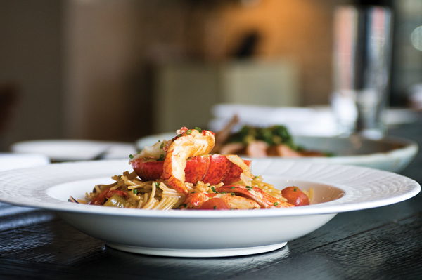 Salero's most magnificent dish: a whole Maine lobster, split and grilled, sitting atop a pile of Manila clams and firm fideos