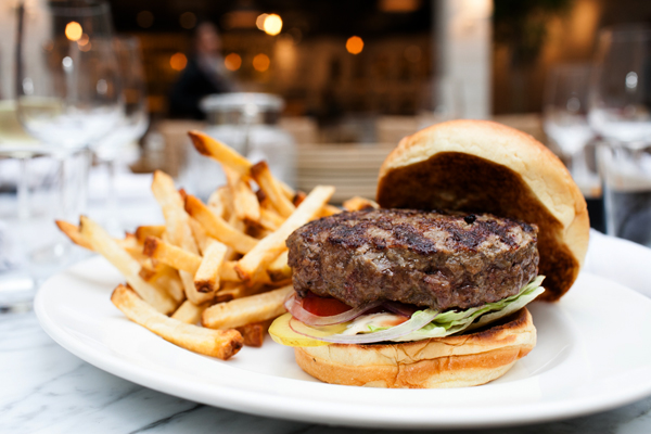 The restraint shown with the burger allows a full appreciation of the thick, flame-kissed patty.
