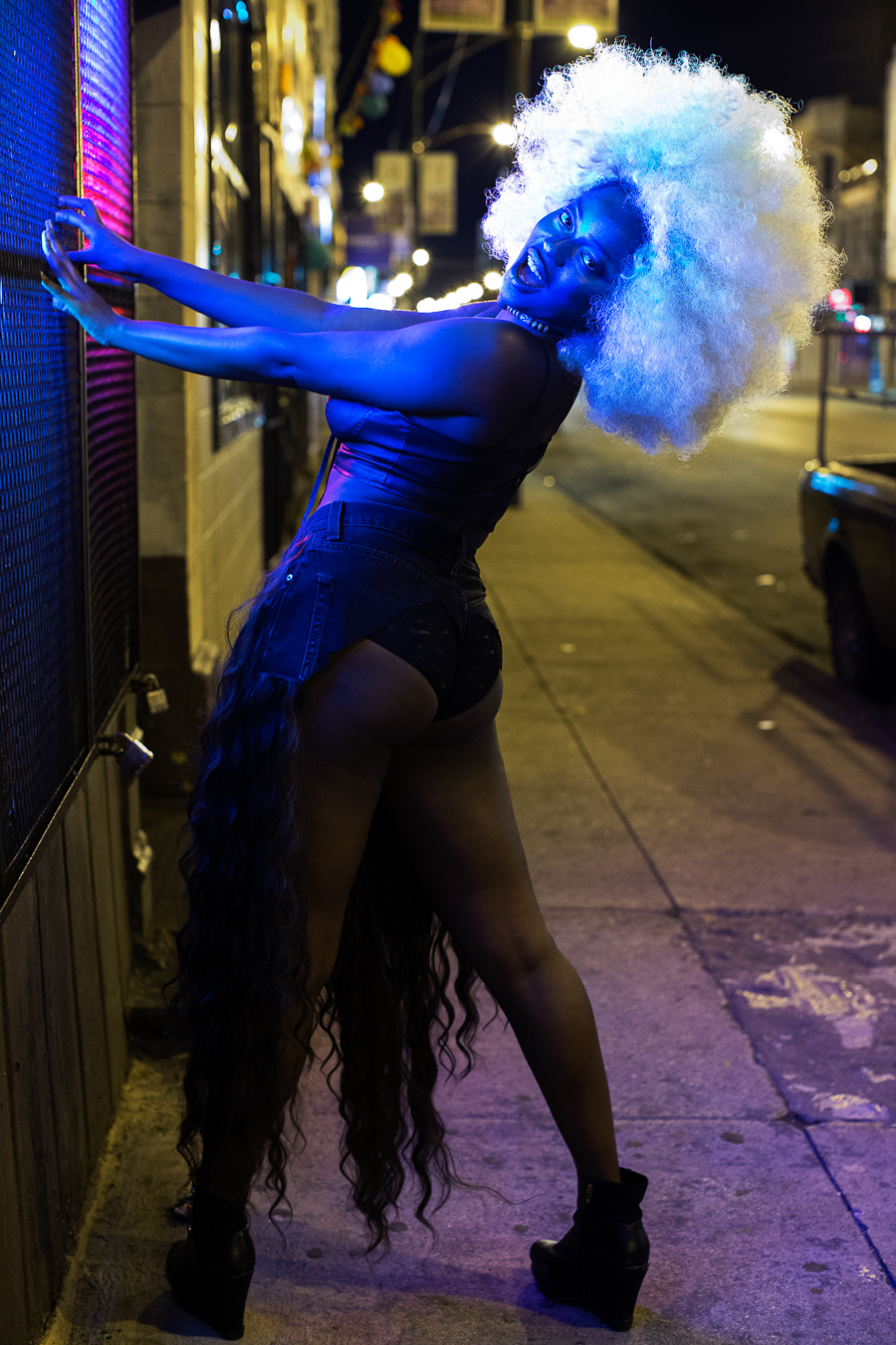 """Ebijimi uses her curly wigs to both critique stereotypes of black femininity and take pride in it. """"I am a black femme,"""" she says. """"I only perform songs by black femmes. I reference a lot of black culture in how I dress."""""""