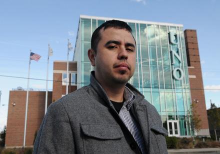 David Corral in front of Major Hector Garcia High School