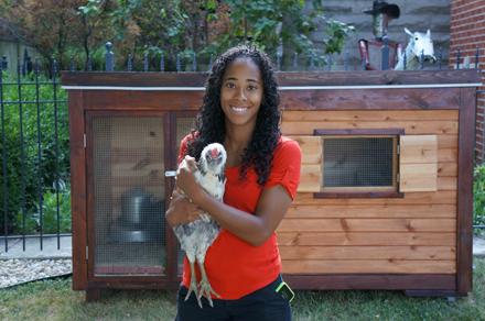 McCall with one of her chickens