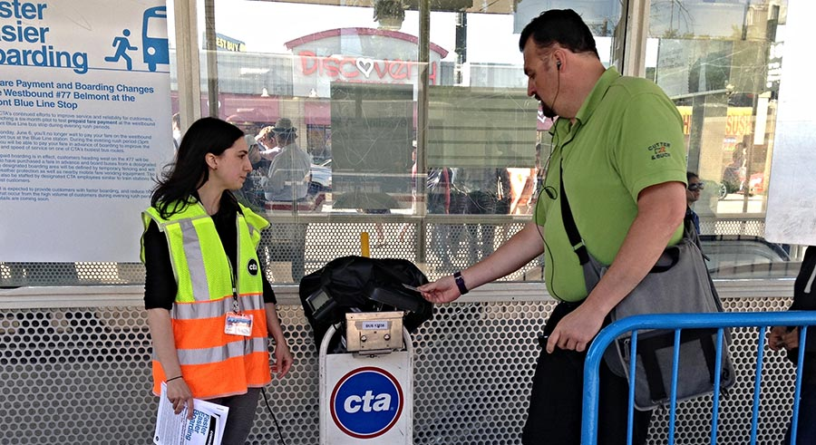 Tapping a Ventra card on the portable reader to enter the paid waiting area.