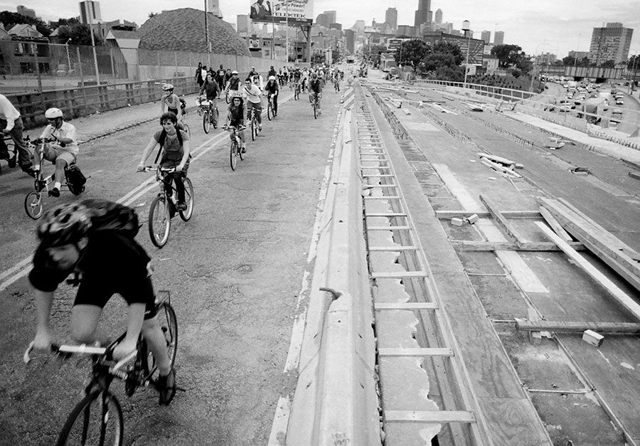 Chicago Critical Mass riders cross the Kennedy Expressway on Milwaukee Avenue during the first monthly ride on September 5, 1997.