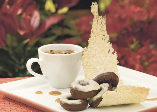 Jam's coffee-glazed cake doughnuts with gianduja, graham cracker tuile, and milk jam