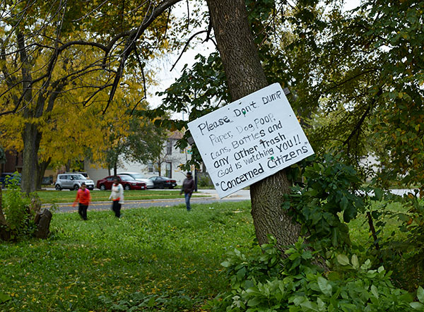 A sign posted in a vacant lot near the house Veronica Coney rents