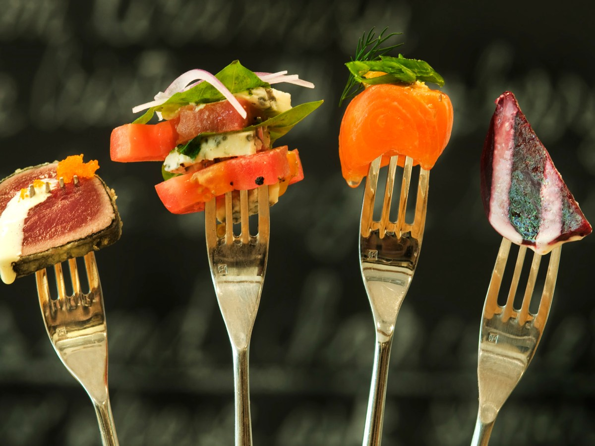 Duo of tuna, tomato salad, salmon sashimi, and roasted beet salad at Grocery Bistro