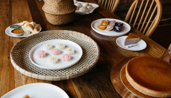 "Clockwise, from the center: khanom chan, blossom-shaped steamed cakes; a khanom pang-sangkhaya set; ""buddy buns;""  ""sibling"" cakes; taro chiffon cake; Khanom Tokyo"