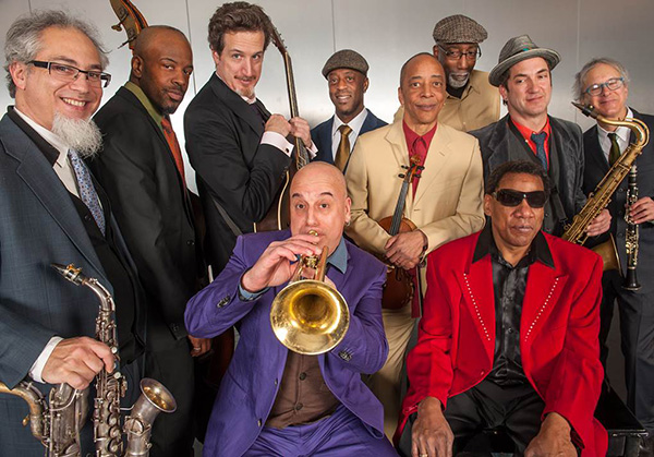 Henry Butler (with sunglasses), Steven Bernstein (with trumpet), and the Hot 9