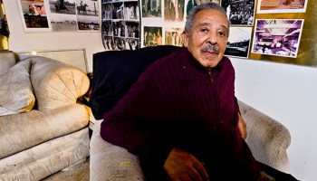 The walls of Herman Roberts's south-side living room are covered with photographs from his decades in the entertainment business.