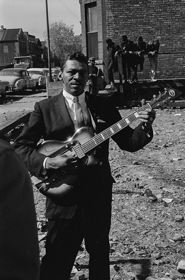 Little Walter playing guitar near Maxwell Street in the early 1960s