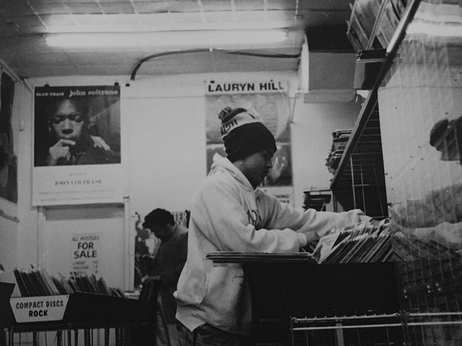 Ibrahem Hasan of Bless the Mad circa 1998, digging through vinyl at Hyde Park Records