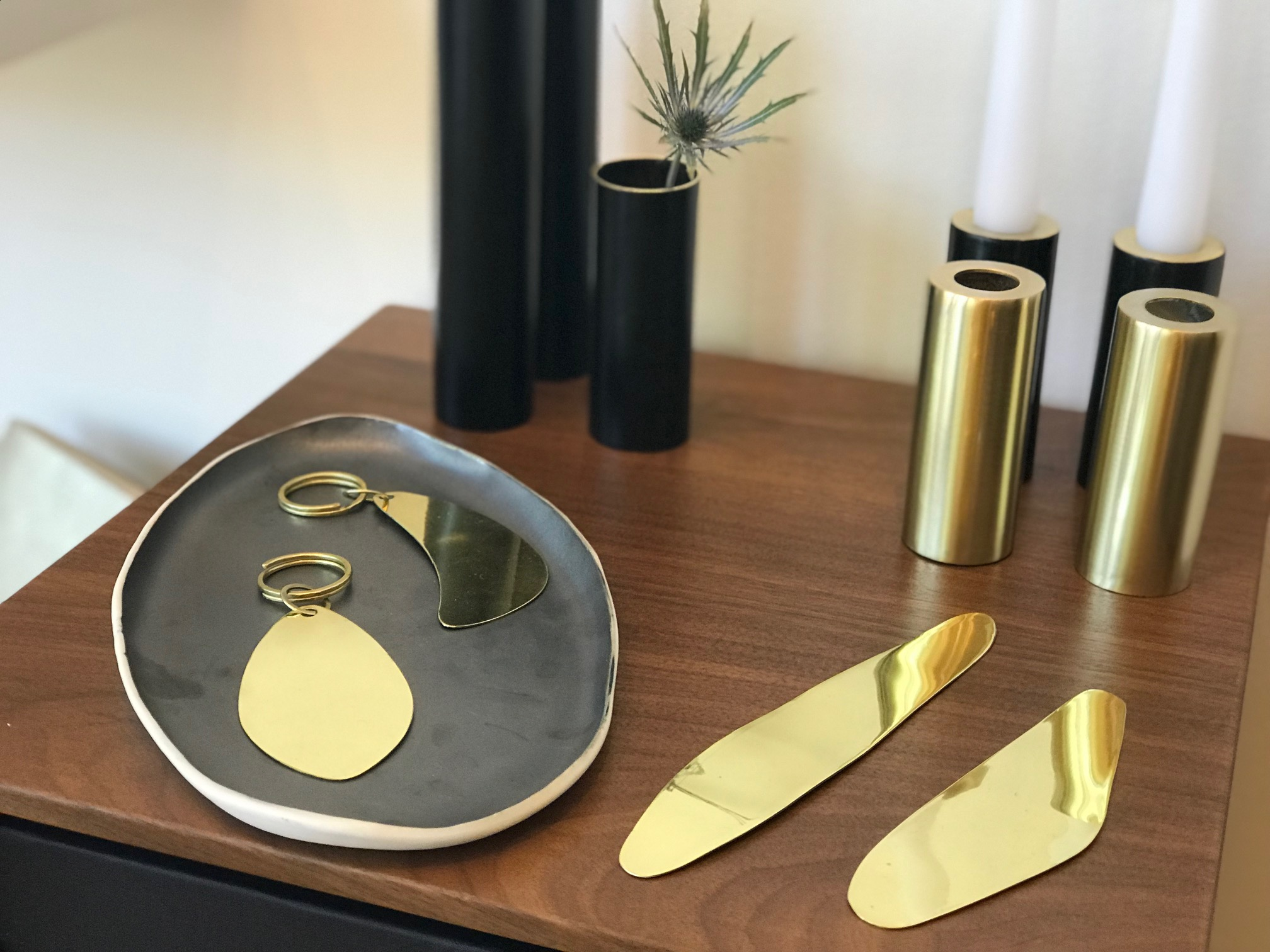 Brass and black enamel pieces by Buenos Aires-based Sibilia