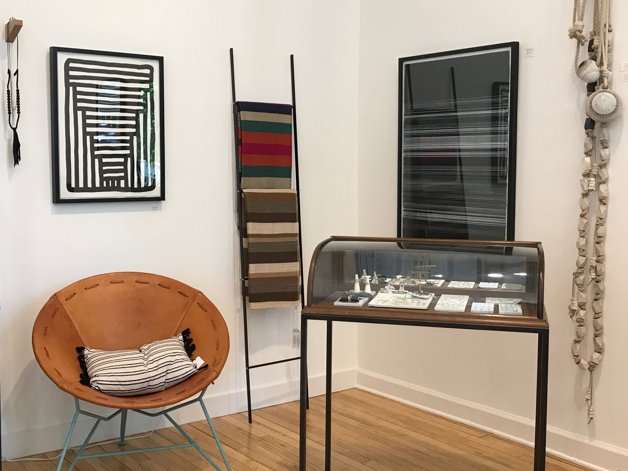 Artwork by Michael McGuire, striped blankets by Garza Marfa, and wall hangings by MQuan Studio