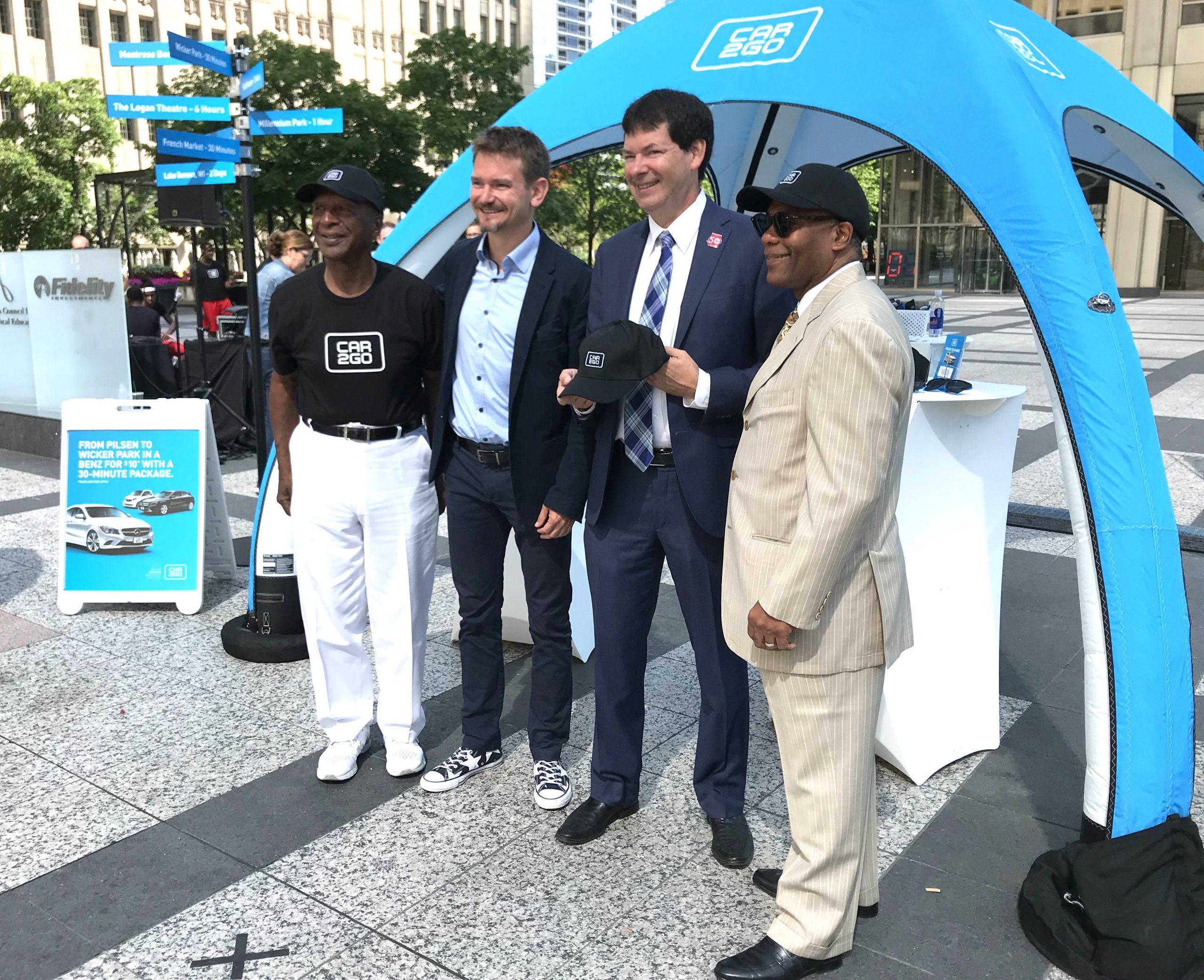 Illinois secretary of state Jesse White, Car2go CEO Olivier Reppert, and aldermen Brian Hopkins and Walter Burnett.