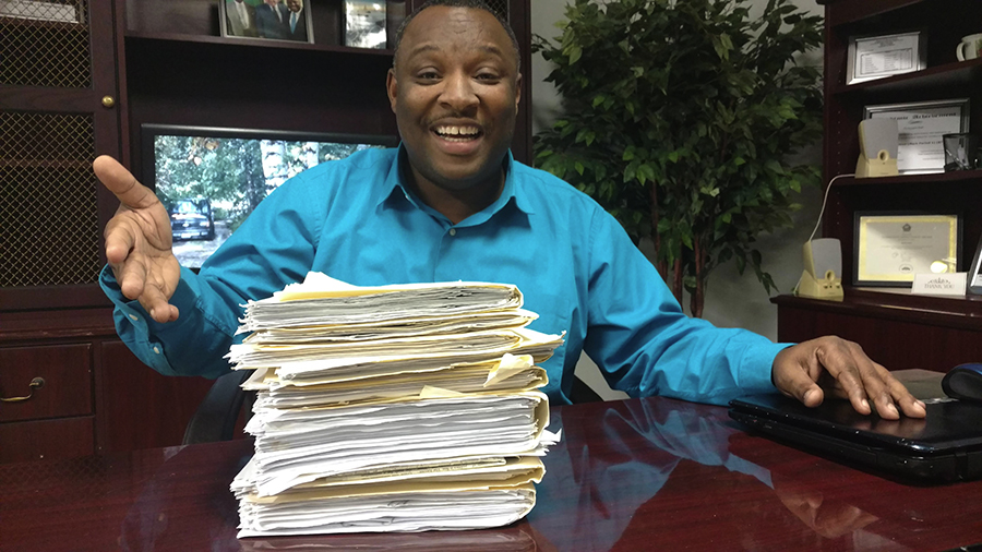 Twentieth Ward aldermanic candidate Andre Smith, who's run for the seat unsuccessfully two previous times against Cochran. Here he's showing a stack of affidavits obtained from each person he asked to sign his nominating petitions.
