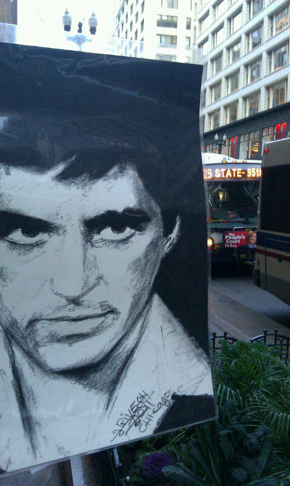 A portrait of Tony Montana in <i>Scarface</i> is part of a display for the artist zebra at State and Madison.