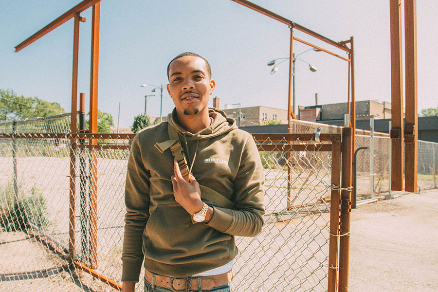 G Herbo on the campus of Anthony Overton Elementary, with the school's former Child Parent Center in the background