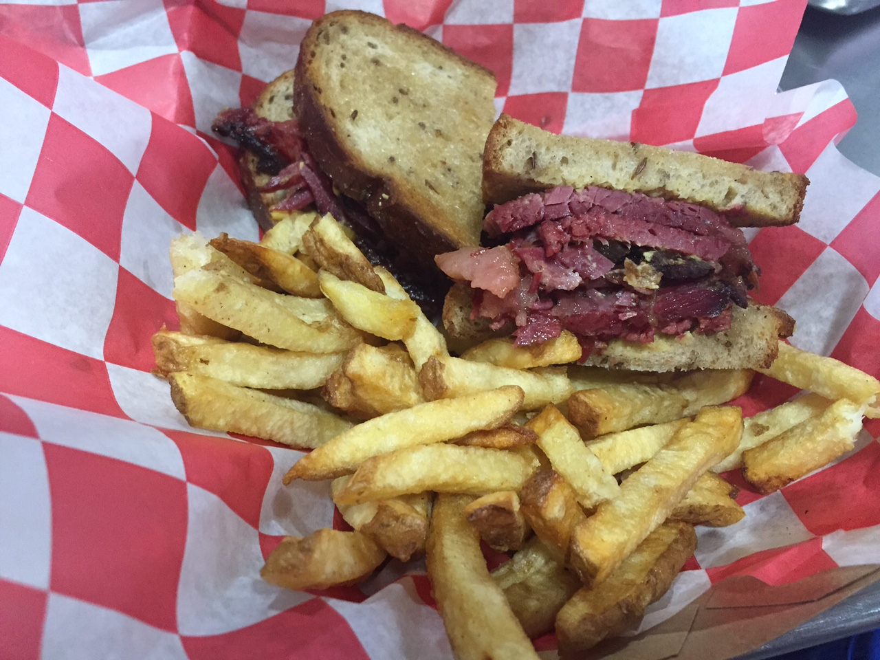 Montreal smoked meat sandwich with fries