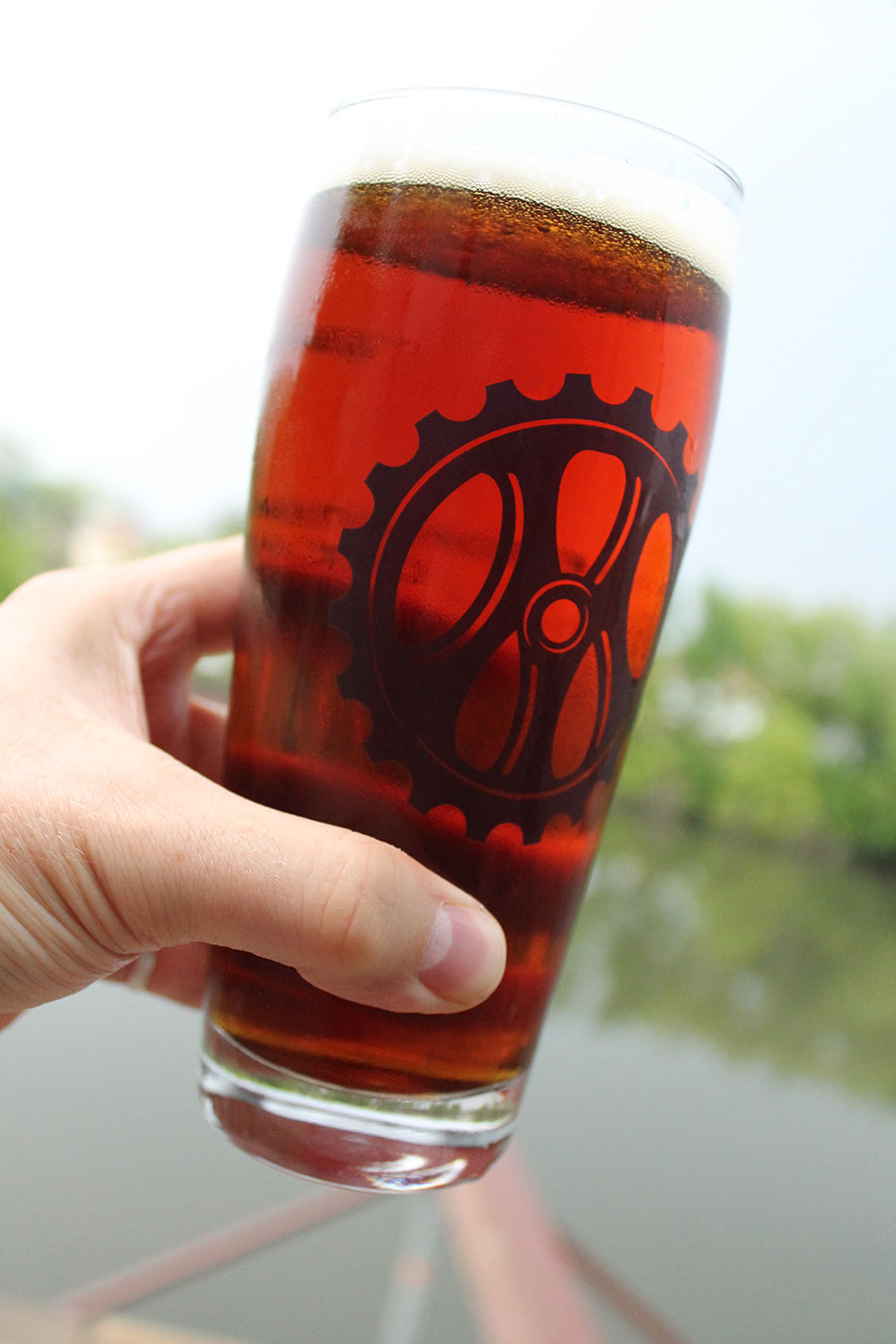 My half-liter glass of Cold Hope on the river overlook of the Metropolitan taproom