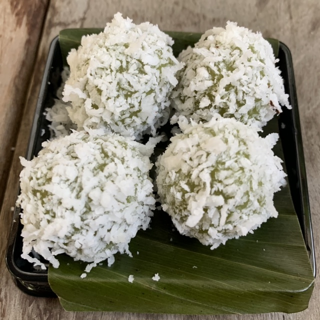 <i>Onde-onde</i>, glutinous rice balls rolled in salted coconut and loaded with an explosion of liquid palm sugar
