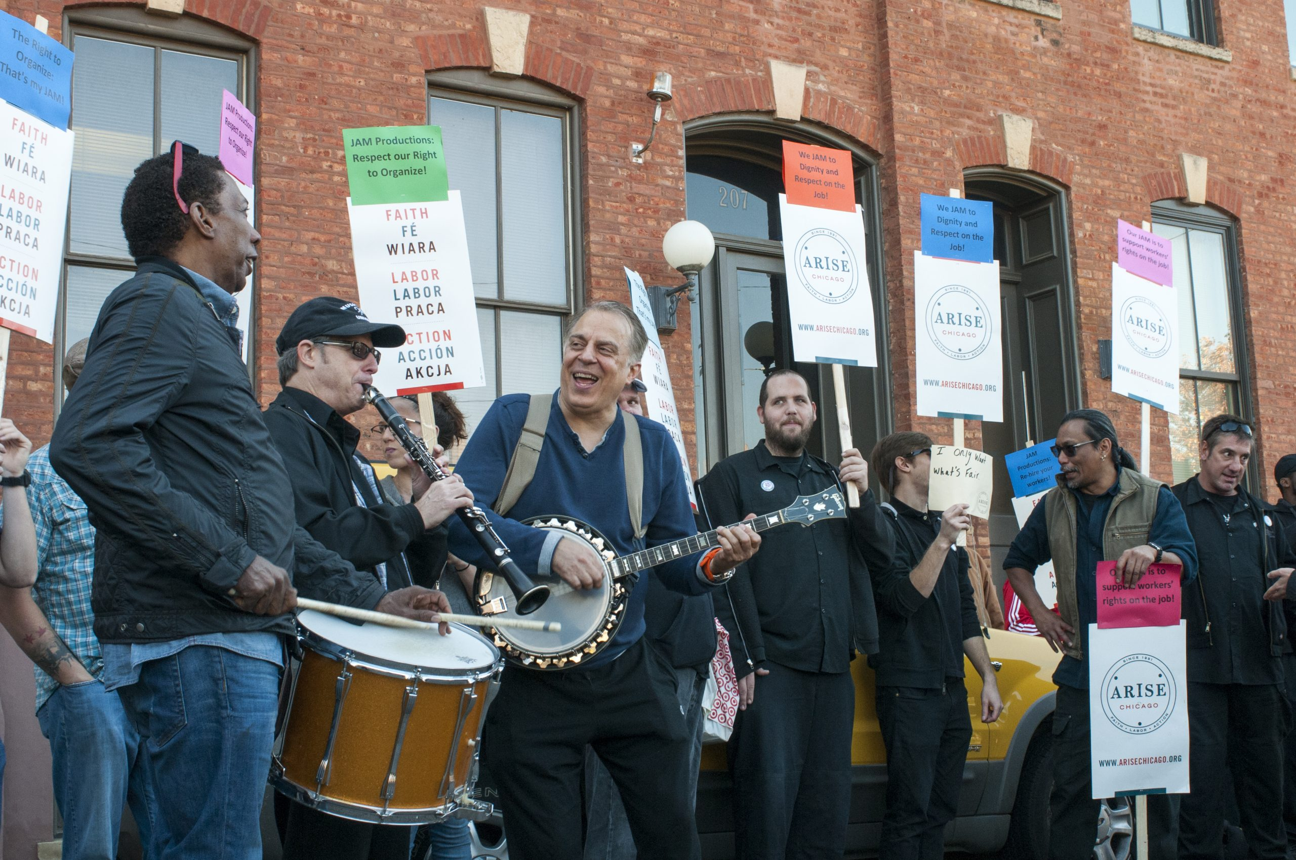 """A pro-union band cheekily calling themselves """"Chicago Federation of Musicians"""" entertain the rally."""