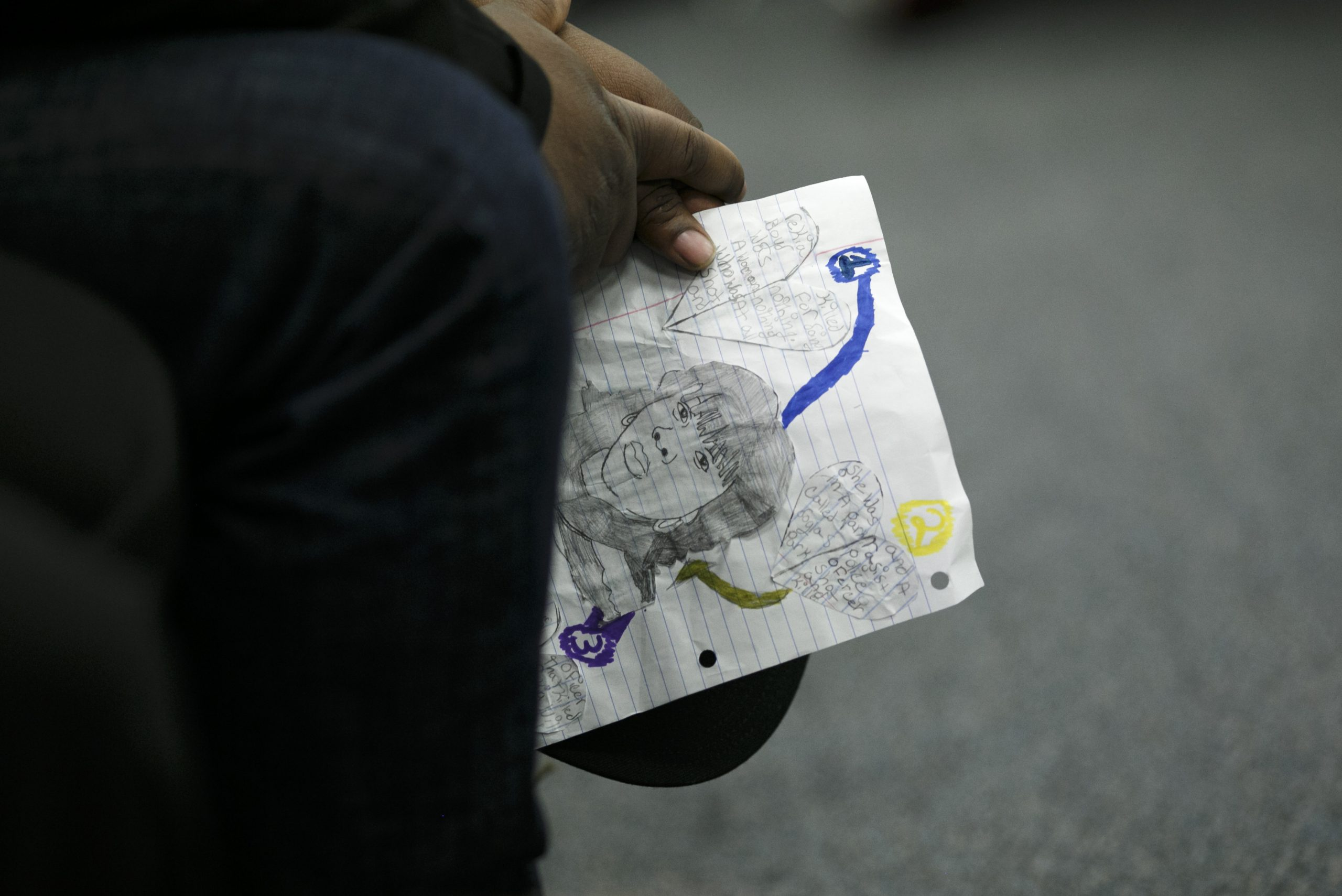 Martinez Sutton holds an illustration of his slain sister, Rekia Boyd, during the November Police Board Meeting.