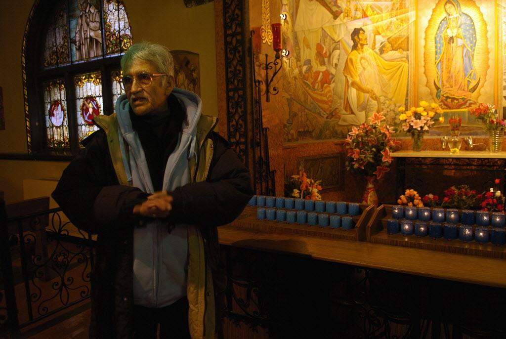 Guerrero shows off a mural inside Pilsen's Saint Pius Church in 2008.