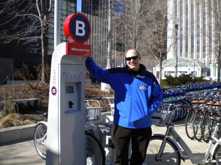 Squire alleges that the city's bike rental contract didn't go to the lowest bidder.