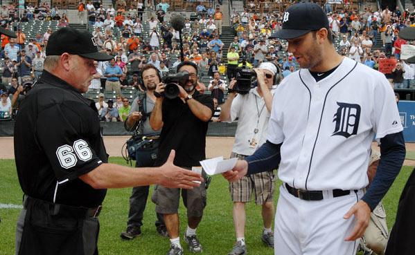 Armando Galarraga handing Jim Joyce the lineup card on June 3 in Detroit