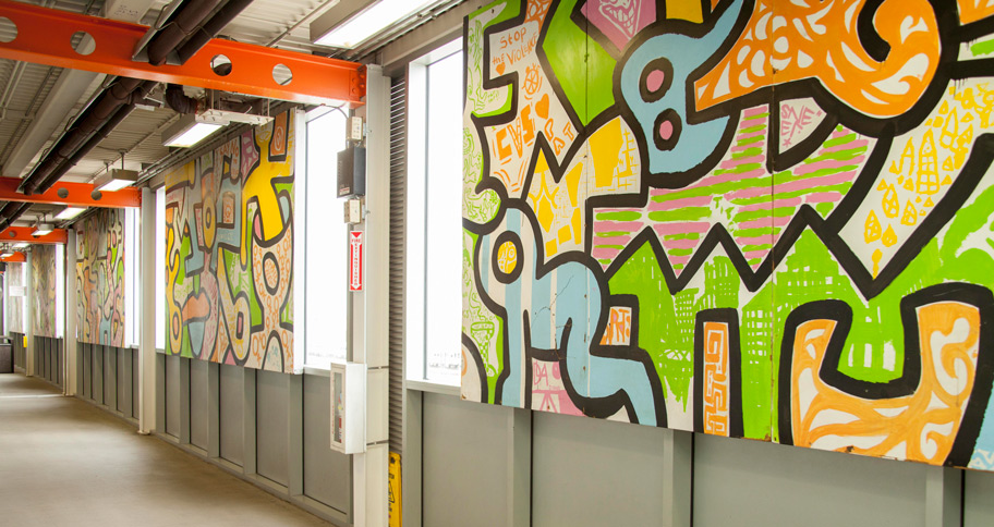 A portion of the mural is on display at Midway in a pedestrian tunnel between the CTA station and the main terminal.