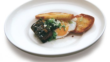 Blood grit cakes with sunny-side up duck egg and crostini