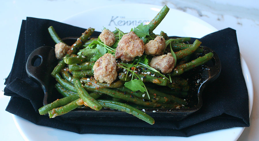 Deep-fried pork brain with haricots verts tossed with sesame vinaigrette, topped with sesame seeds and togarashi, and garnished with cilantro.