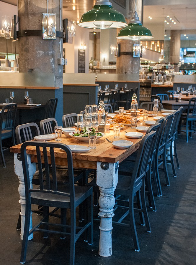 The Kitchen, located in the Reid Murdoch Building, is lovely: chandelier–lit, with exposed concrete, blond wood, and slate-blue accents.