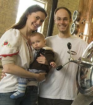 Sonat Birnecker Hart and Robert Birnecker of Koval Distillery with their son, Lion