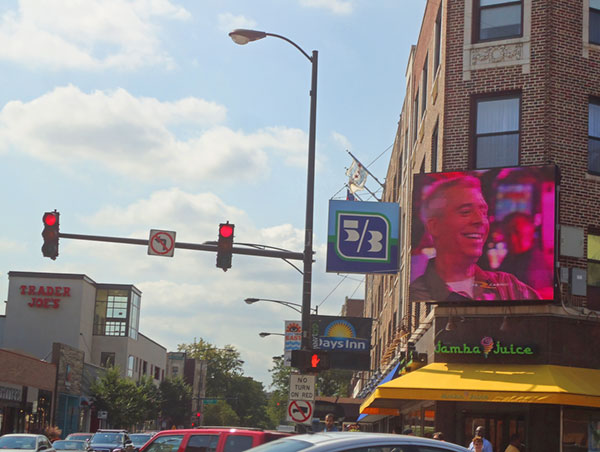 A ten-by-ten LED billboard at Clark and Diversey