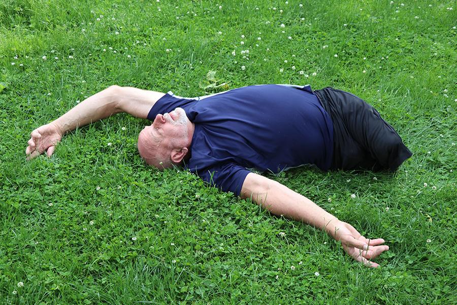 Lenzo exercises at Austin Gardens in Oak Park.
