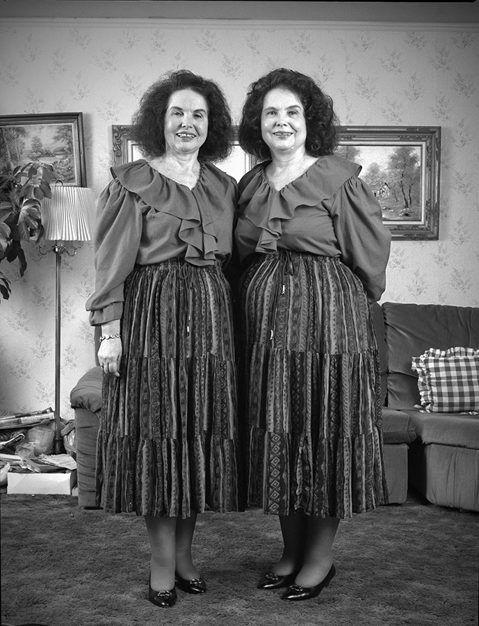 <b><i>Middle-aged twins at home in Chicago</i><br/> By Lloyd DeGrane</b>