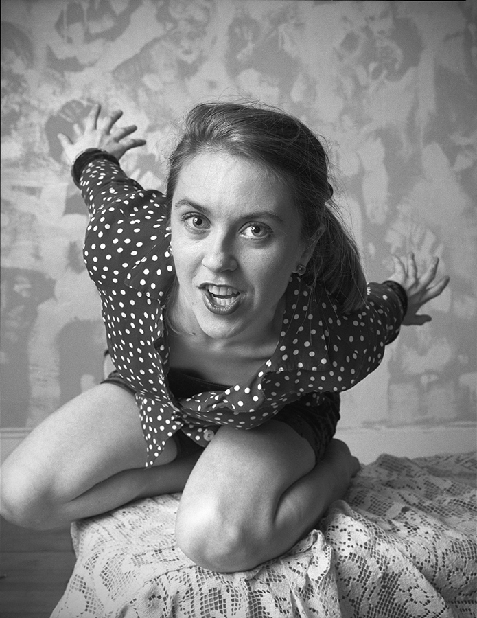 """<b><i>Liz Phair in her Wicker Park apartment</i>, 1993<br/> By Lloyd DeGrane for """"Greetings From Guyville: Liz Phair's Girl-o-centric Exile""""</b><br/><br/> DeGrane says: <i>""""Her clothes were still wet. She had just come back from the laundromat, climbed up on her coffee table, and I took the photo. This was the first public photo of Liz. A month later everyone knew her name.""""</i>"""