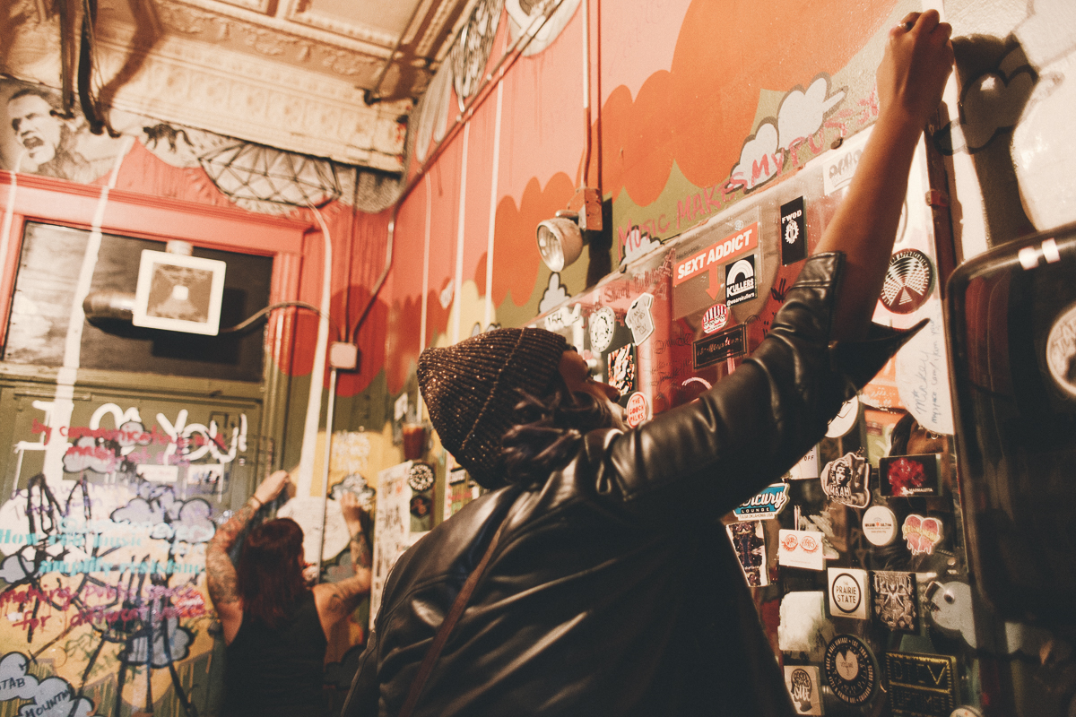 """Guests share their answers to the question """"How can music amplify resistance?"""" on the walls of the Empty Bottle bathroom."""