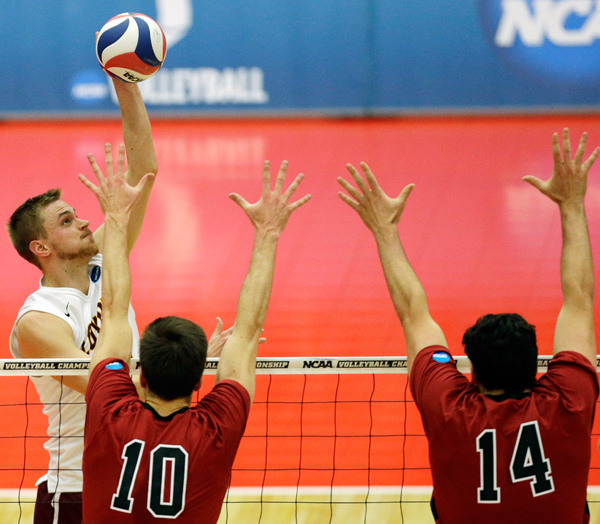 Loyola's Joe Smalzer, left, hits the ball against Stanford's Brian Cook (10) and Spencer Haly (14).