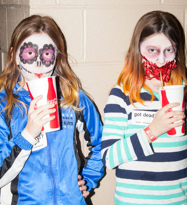 These girls got Cokes and makeovers—one to look like a Tim Burton-esque doll and the other a zombie.