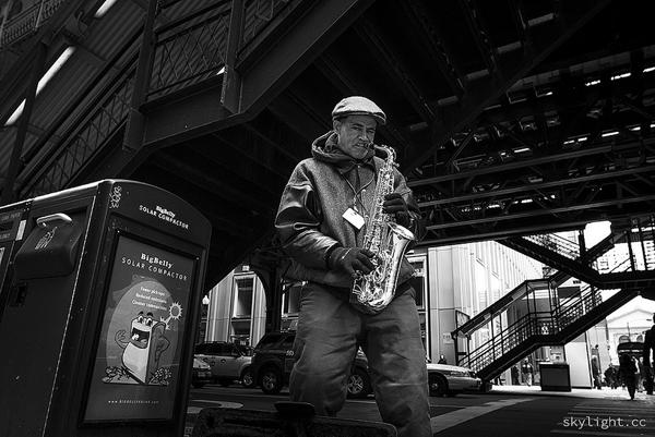 <em>Street Performer.</em> Adams and Wabash, November. By Michael Salisbury